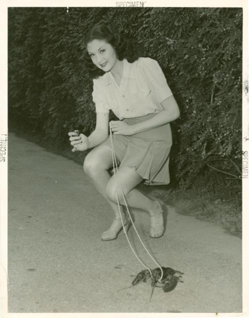 young-woman-walks-pet-lobster